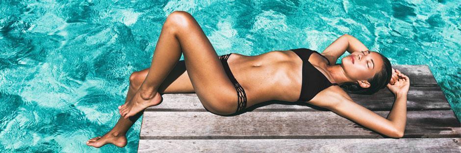 woman with leg in pool