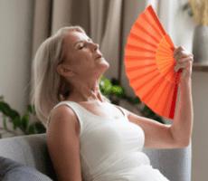 woman waving fan
