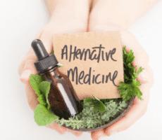 hands extended holding Alternative Medicine sign