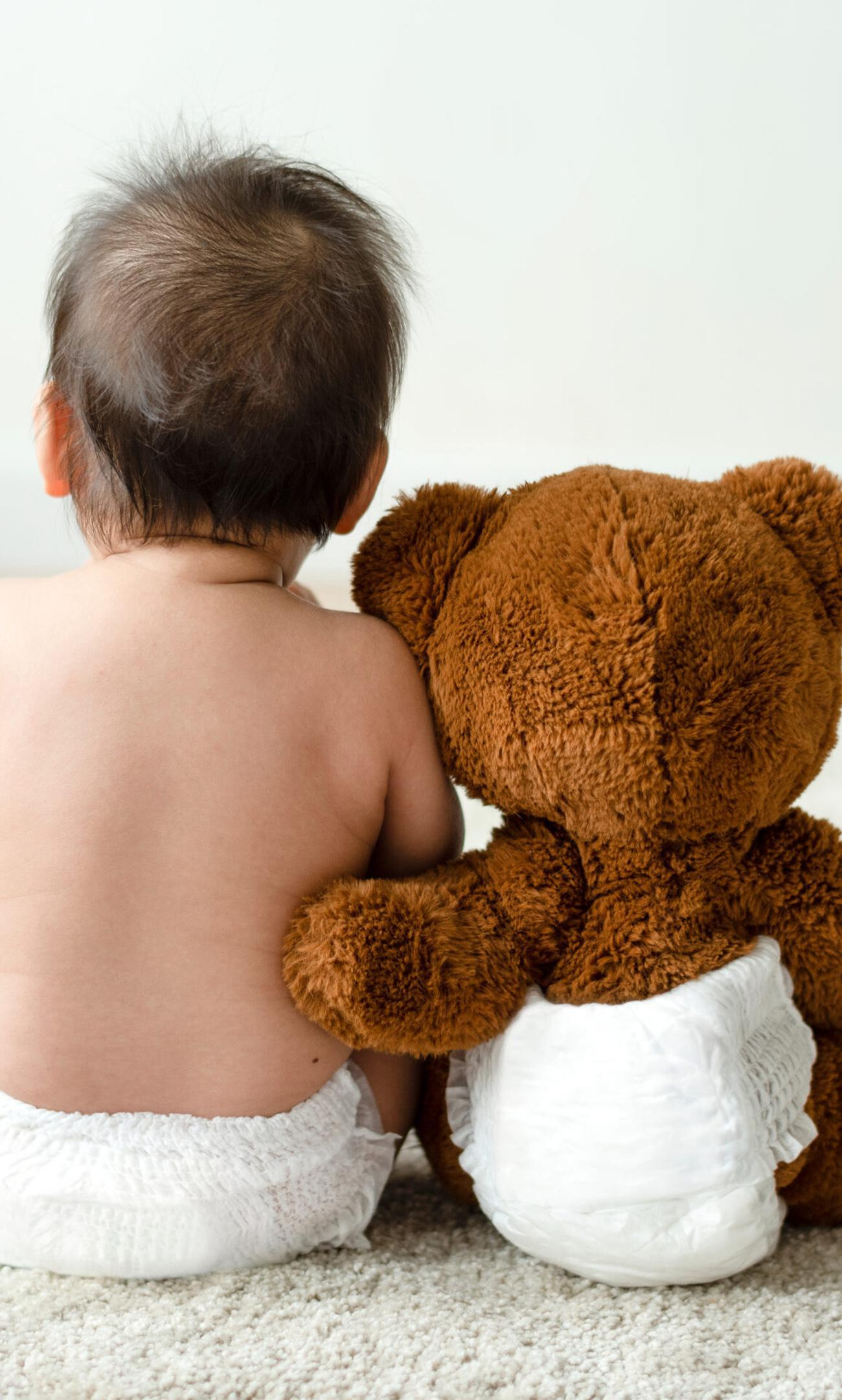 baby and bear sitting down