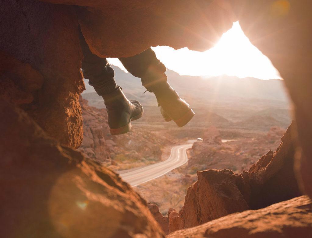 Feet dangling off cliff