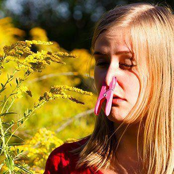 Girl with nose plugged