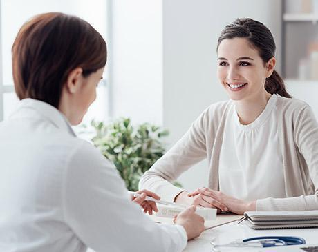 woman meeting with physician