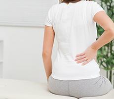 Woman experiencing sciatic pain