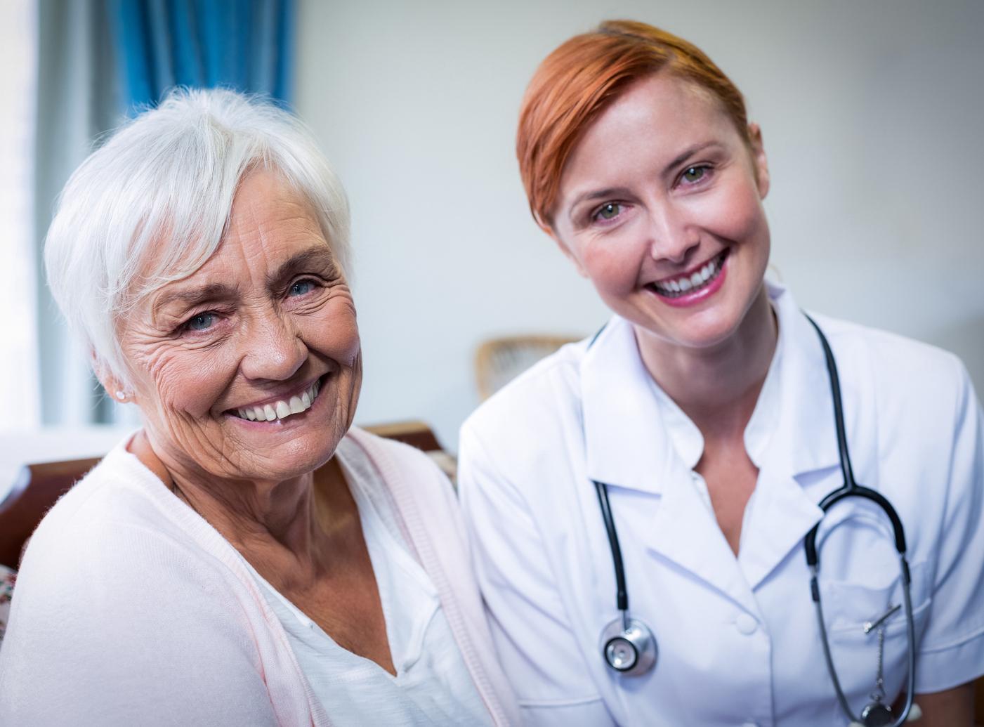 Smiling medical marijuana doctor and patient.