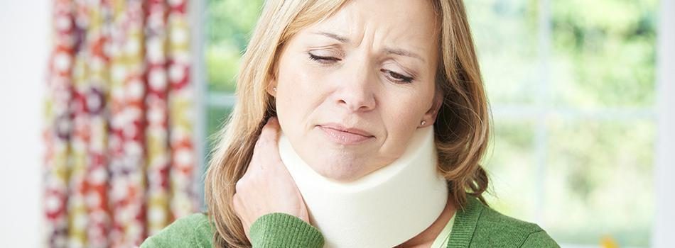 Woman experiencing whiplash