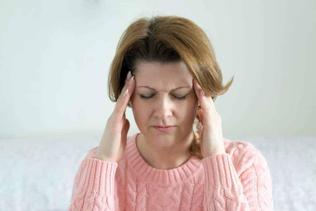 photo of woman with headache