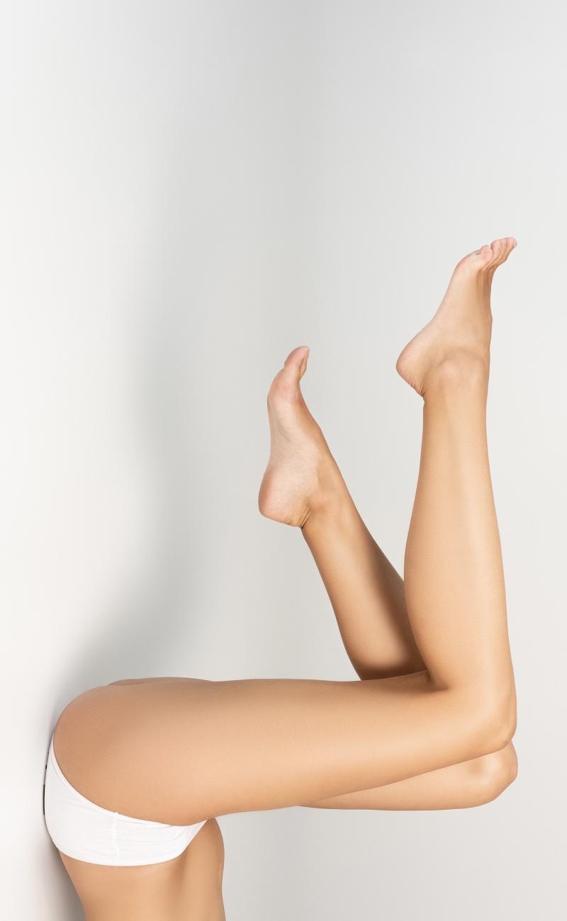 Photo of lady holding legs