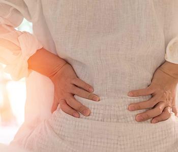 Woman experiencing pelvic organ prolapse