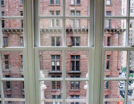 View of brick building through windowpanes.