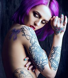 woman with a lot of tattoos