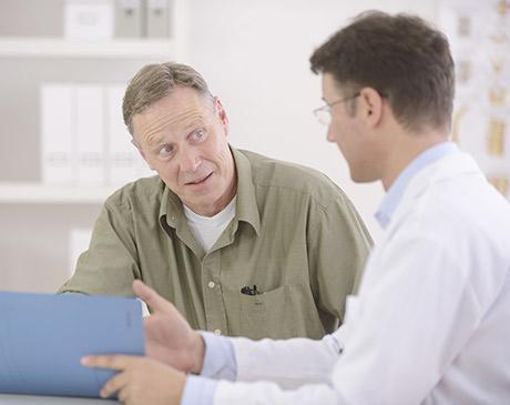 physician talking to man