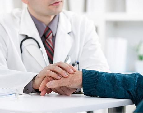 physician hand placed on patients hand
