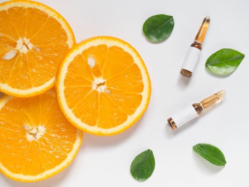 orange slice leaves and vitamin vials