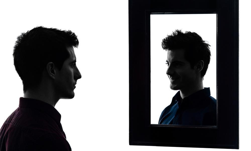 man looking in mirror