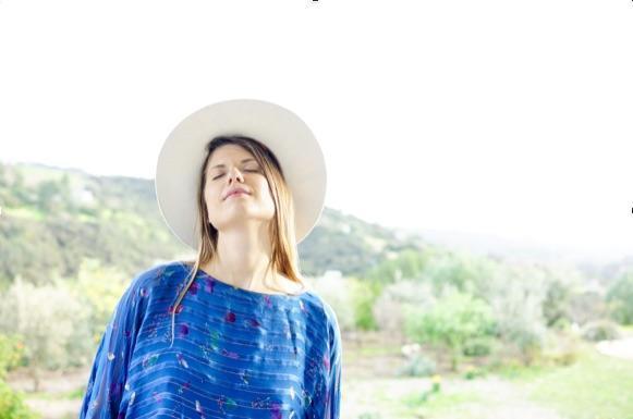 Woman wearing hat enjoying sun