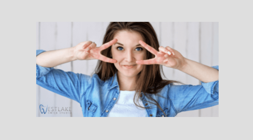 Woman smiling with peace signs