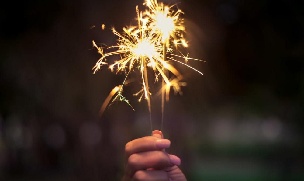 Close-up of hand holding sparklers on New Year's.