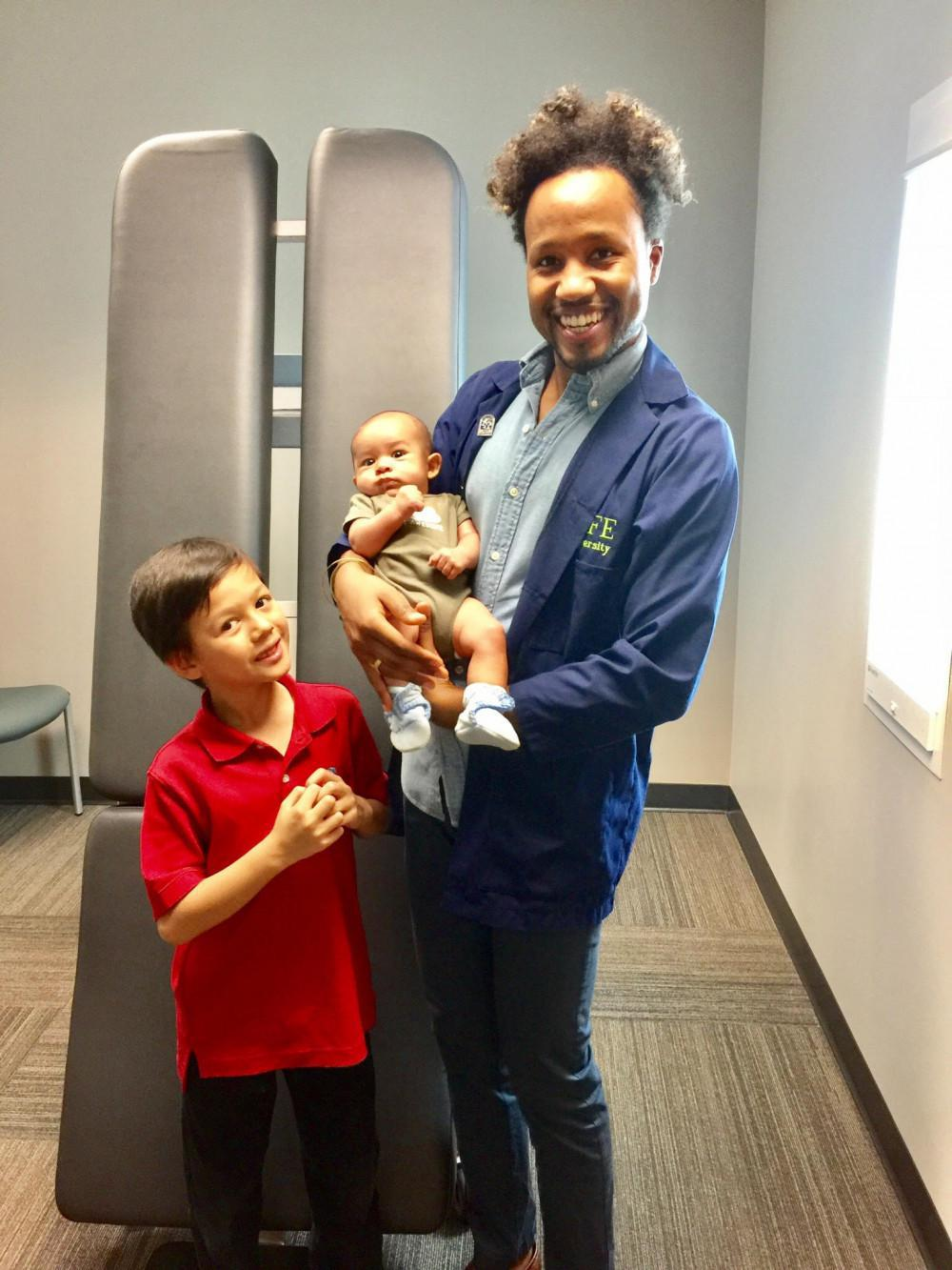 Dr. Darrien and Caleb after his 1st adjustment.
