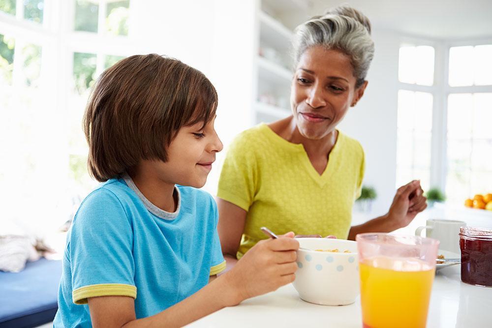 Grandmother & Grandson Enjoying Breakfast