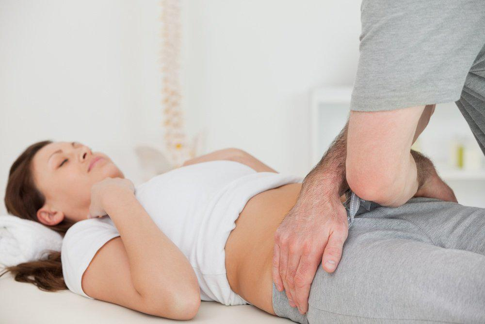 woman getting treated for hips