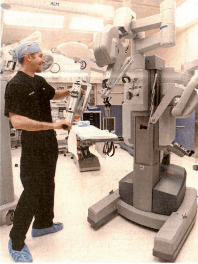 surgeon with robotic machine