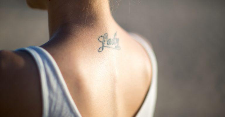 woman with tattoo on neck