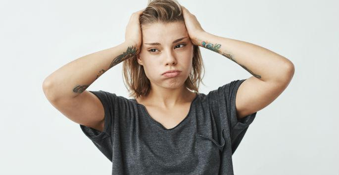 frustrated woman with tattoos