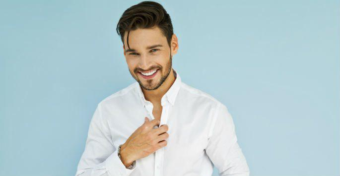 man in button down shirt smiling