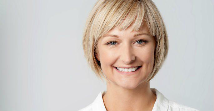 woman with short hair smiling