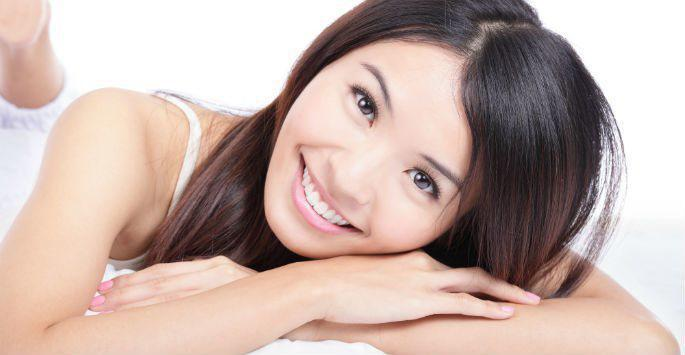 woman lying on stomach and smiling
