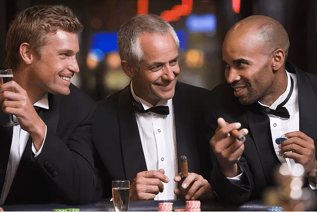 well dressed men with drinks and cigars