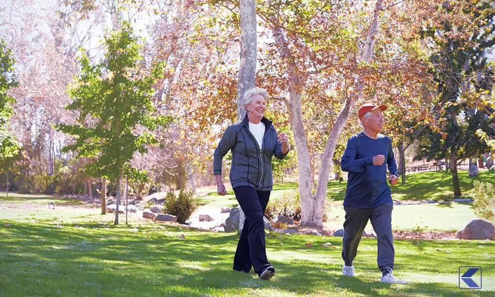 Older couple walking at the park