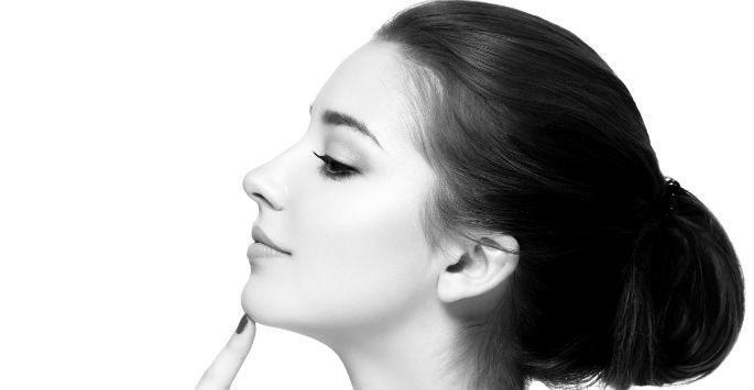 woman in profile touching her chin