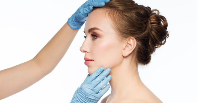 dermatologist checking woman's skin