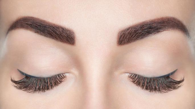 close up of eyebrows and closed eyelashes