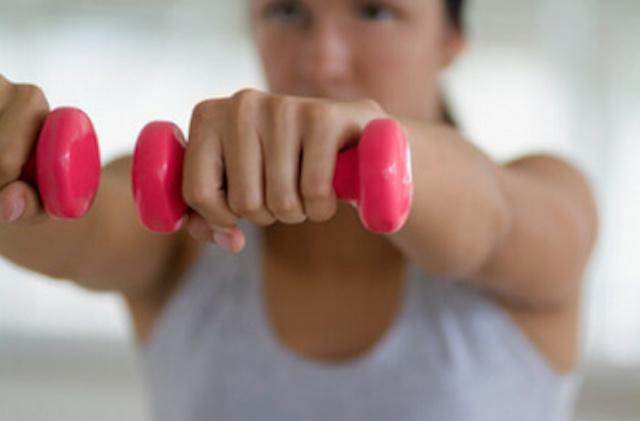woman holding up weights