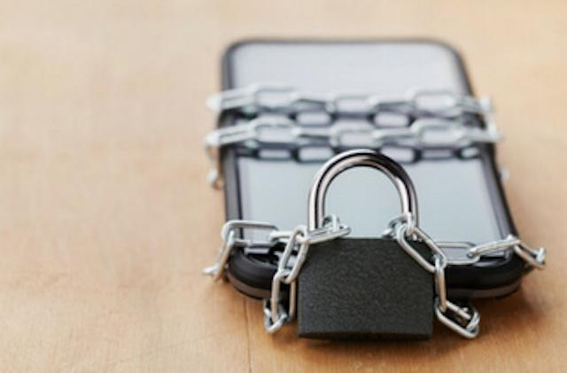 cell phone in chains with a padlock