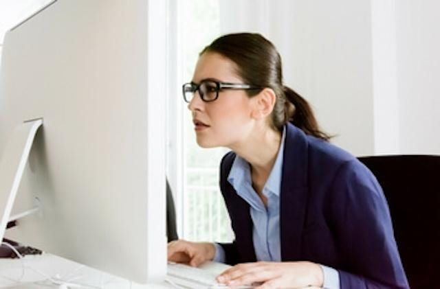 woman slouching in front of computer