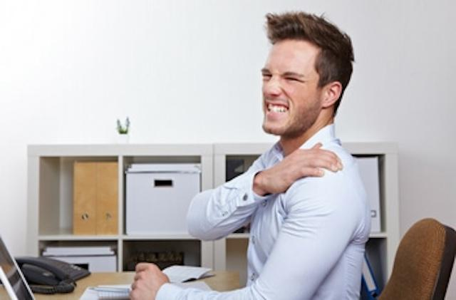 man with back pain at work