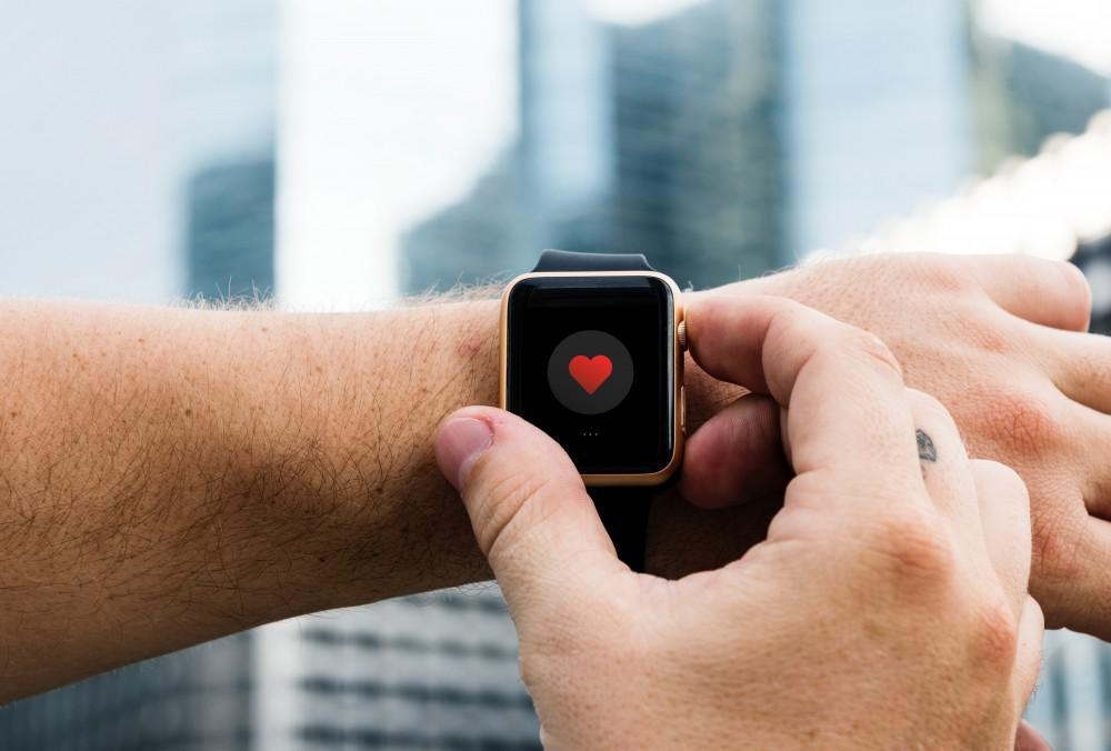man wearing an apple watch tracking his health app