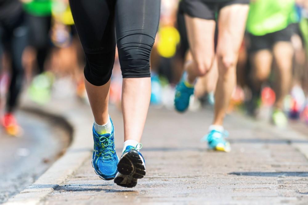 Stockholm Marathon runners viewed from knee level