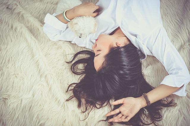 girl napping with dog