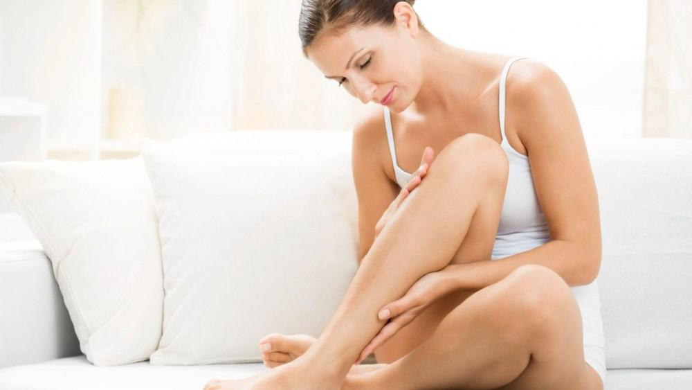 Woman examining legs for psoriasis