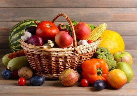 A basket of vegetables and fruit highlighting Autumn's bounty