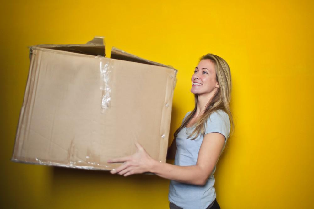woman holding cardboard box