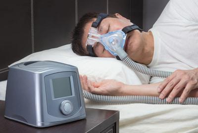 man sleeping with machine
