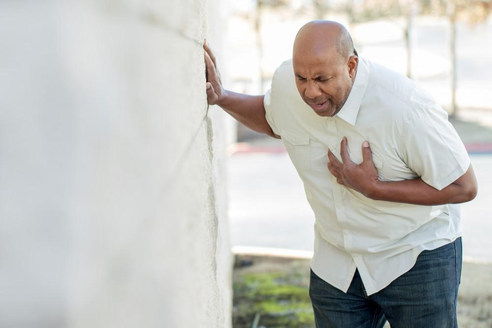 Man grabbing chest.