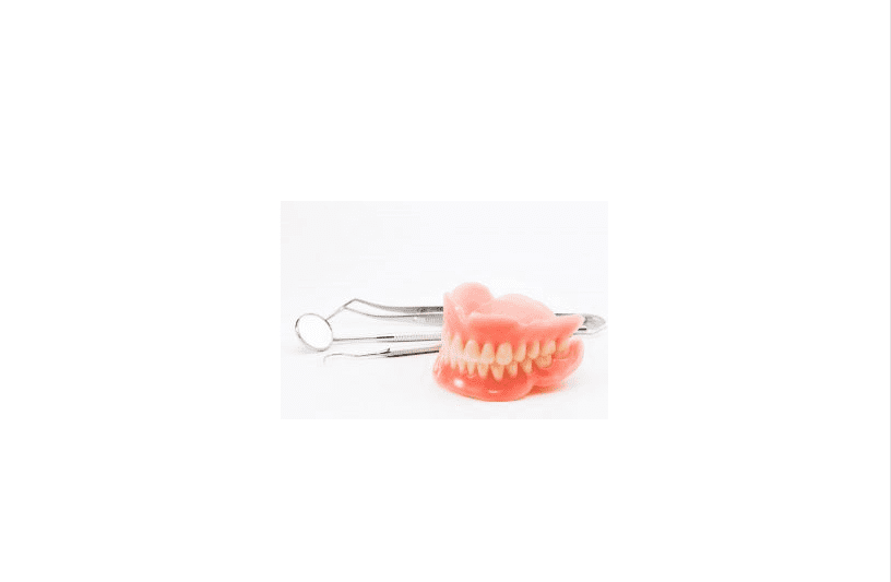 Dental tools and a pair of dentures.