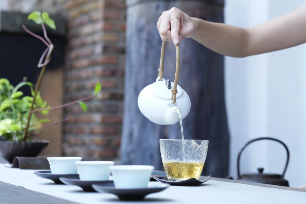 Woman Pouring Tea.
